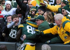 Brandon Bostick gets his first Lambeau Leap in one of the few Packer high lights