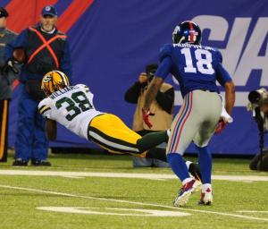 Tramon Williams makes a diving interception